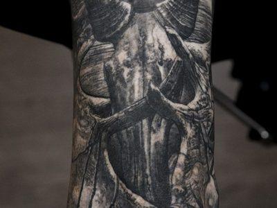 black and grey tattoo, realism tattoo, surrealism tattoo , smooth shading tattoo ,surrealism tattoo, bull skull and dear horns tattoo, bird sitting on mans hand tattoo, wild life and leaves tattoo