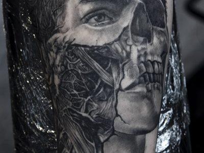 black and grey tattoo, realism tattoo, surrealism tattoo , smooth shading tattoo, human skull anatomical head, human anatomical head, ripped skin and anatomical muscle tattoo