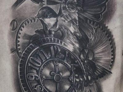 black and grey tattoo, realism tattoo, surrealism tattoo , smooth shading tattoo, swallow tattoo, flying swallows tattoo, reasltic swallow tattoo, swallow and pocket watch tattoo, flying time tattoo piece