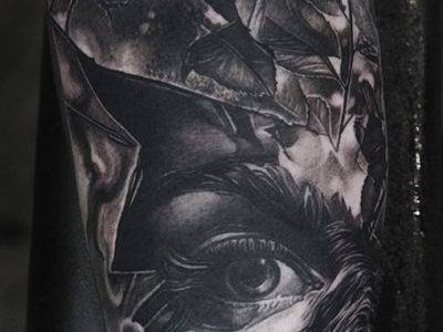 black and grey tattoo, realism tattoo, surrealism tattoo , smooth shading tattoo ,surrealism tattoo, woman eye and eagle tattoo, eagle tattoo, wild life and leaves tattoo, woman eye looking trough shattered glass tattoo