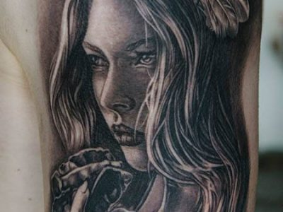black and grey tattoo, realism tattoo, surrealism tattoo , renaissance tattoo, angel tattoo, protective angel tattoo, angel and roses tattoo, angel with wings spread out