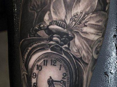black and grey tattoo, realism tattoo, surrealism tattoo , smooth tattoo, pocket watch tattoo, time tattoo, clasic time tattoo, roses and pocket watch tattoo