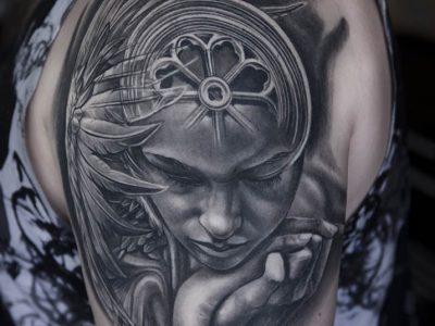 black and grey tattoo, realism tattoo, surrealism tattoo , renaissance tattoo, angel tattoo, protective angel tattoo, biblical angel tattoo, religious tattoo