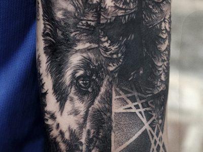 black and grey tattoo, realism tattoo, surrealism tattoo , smooth shading tattoo, wolf dog portrait tattoo, forest and mountain geomtric style tattoo, illustrative wolf tattoo