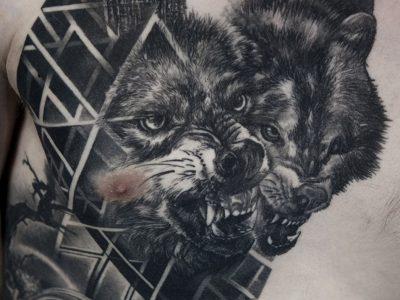 black and grey tattoo, realism tattoo, surrealism tattoo , smooth shading tattoo, wolfs in forest howling and geomtry tattoo, black forest tattoo, illustrative wolfs tattoo
