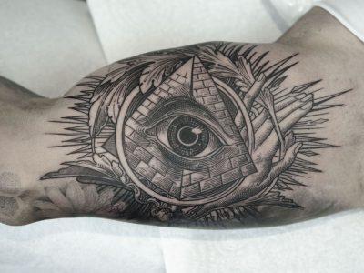 Black and grey tattoo, best black and grey tattoo, smooth shading tattoo, illuminati illustrative tattoo, pyramid and all seeing eye tattoo, surrealism illuminati tattoo