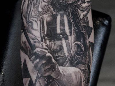Black and grey tattoo, best black and grey tattoo, smooth shading tattoo, american indian tattoo, indian warrior and horse realism tattoo, indian battle scene tattoo, illustrative indiant tattoo