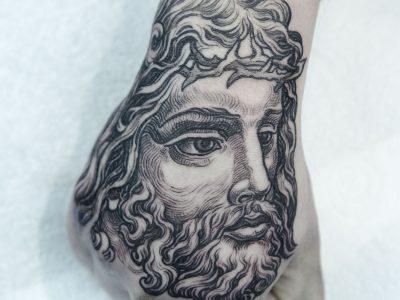 Black and grey tattoo,best black and grey tattoo, Jesus tattoo, angel tattoo, apocalyptic tattoo,, renaissance tattoo, , smooth shading tattoo, religious tattoo, saint tattoo, god tattoo, illustrative jessus portrait on hand tattoo