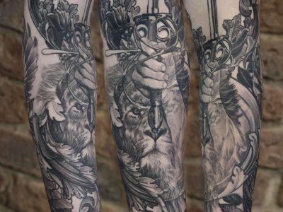 Black and grey tattoo,best black and grey tattoo, smooth shading tattoo, realistic lion tattoo, lion and hunter tattoo, hand and sword tattoo, king of the jungle tattoo, surrealism lion tattoo