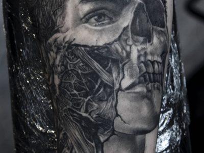 Black and grey tattoo best black and grey tattoo, anatomy face and skull tattoo, anatomy human head tattoo, realistic human head tattoo, surrealistic half skull half human face tattoo, portrait tattoo , medical anatomy tattoo