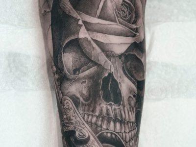 Black and grey tattoo, best black and grey tattoo, smooth shading tattoo, rose realistic tattoo, skull tattoo, compass and ship tattoo, marine surrealistic tattoo, navigation realism tattoo, map tattoo, old gun tattoo. sailing tattoo, pirate tattoo, bespoke tattoo