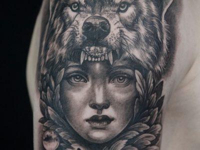 Black and grey tattoo, best black and grey tattoo, smooth shading tattoo, wolf Tattoo , American Indian tattoo, native American tattoo, surrealistic woman and wolf tattoo, hand drawing tattoo, portrait tattoo, surrealistic tattoo, realism tattoo, legend tattoo, mythology tattoo, Unique art tattoo, photorealism tattoo,