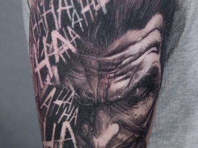 Black and grey tattoo, best black and grey tattoo, smooth shading tattoo, Joker Tattoo , villain tattoo, batman tattoo, surrealistic tattoo, hand drawing tattoo, comic books tattoo, evil tattoo, o, realism tattoo, legend tattoo, tattoo, Unique art tattoo, photorealism tattoo, portrait tattoo, super hero tattoo
