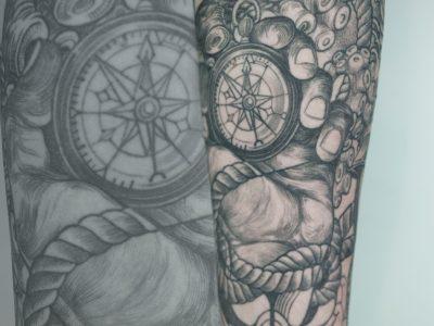 black and grey tattoo, realism tattoo, surrealism tattoo , smooth tattoo , skull and ship tattoo, octopus tattoo , sailing tattoo, dark art tattoo, art tattoo, sailor tattoo, navigation tattoo, compass tattoo, photo realism tattoo, surrealism tattoo, portrait tattoo, arm tattoo, forearm tattoo, full sleeve tattoo, hand holding compass tattoo, waves tattoo