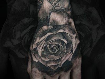 Black and grey tattoo, best black and grey tattoo, smooth shading tattoo, rose Tattoo , hand tattoo, flower tattoo, surrealistic rose tattoo, hand drawing tattoo, t, surrealistic tattoo, realism tattoo, legend tattoo, mythology tattoo, Unique art tattoo, photorealism tattoo, organic tattoo, romantic tattoo