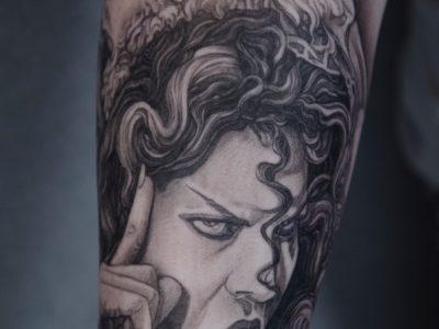 Black and grey tattoo, best black and grey tattoo, smooth shading tattoo, portrait tattoo , cinema tattoo, actor tattoo, surrealistic woman tattoo, The house of 1000 corpses tattoo, surrealistic tattoo, realism tattoo, Baby firefly tattoo, cherry moon tattoo, Unique art tattoo, photorealism tattoo, High details tattoo, forearm tattoo, full sleeve tattoo,